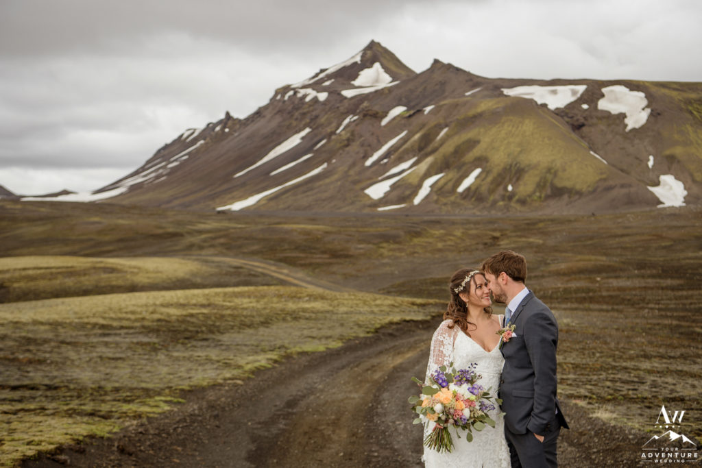 Adventurous Iceland wedding couple cuddling on an F-Road