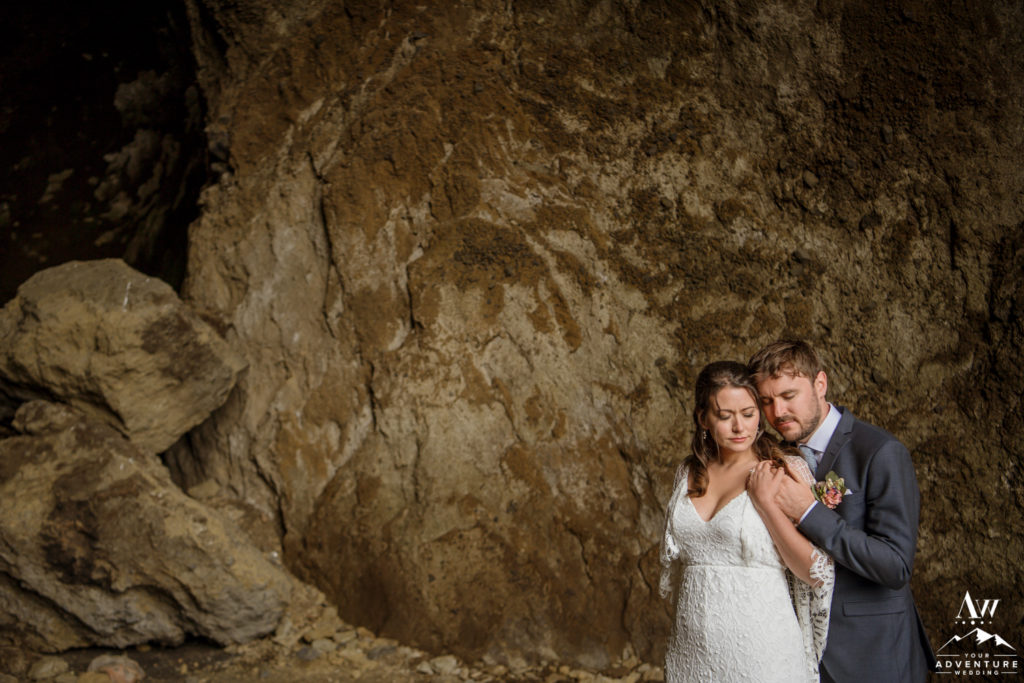Iceland Wedding Couple Cuddling inside of hjorleifshofdi cave