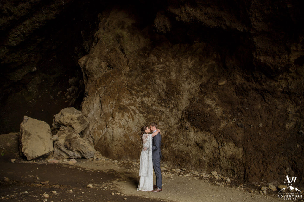 Iceland Wedding Couple kissing inside of hjorleifshofdi cave