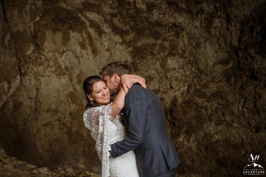 Iceland Bride Laughing with Groom inside of hjorleifshofdi cave