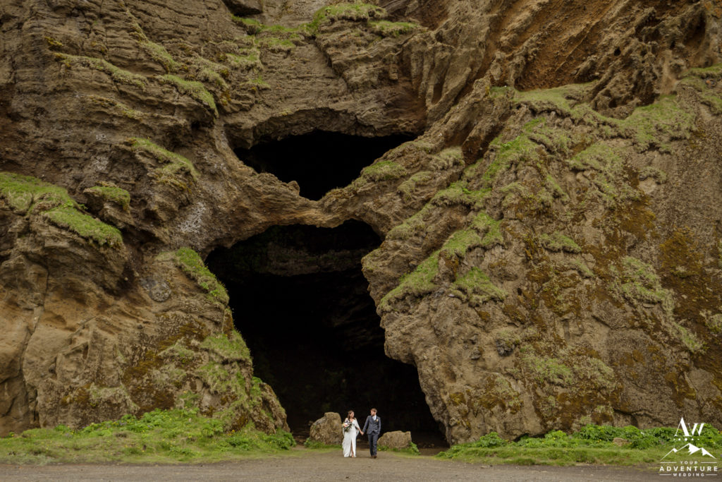 hjorleifshofdi cave wedding couple on the outside of the cave