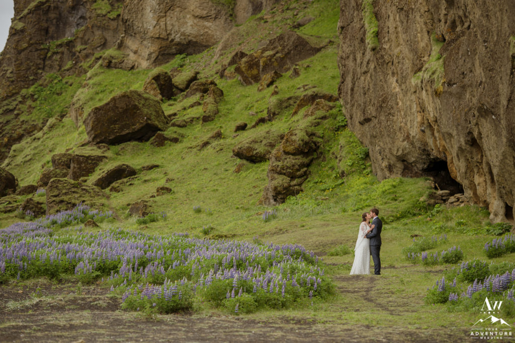 Adventurous Elopement Couple exploring a field of Lupine