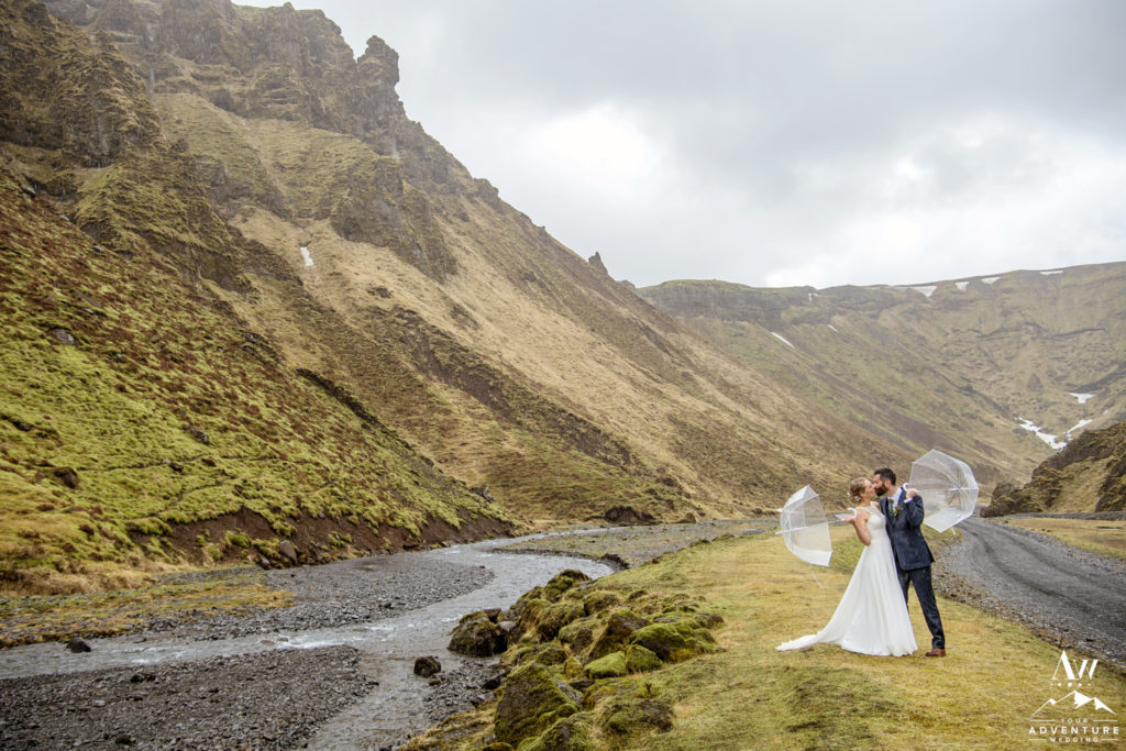 Iceland Wedding Couple Kissing with Clear Umbrellas