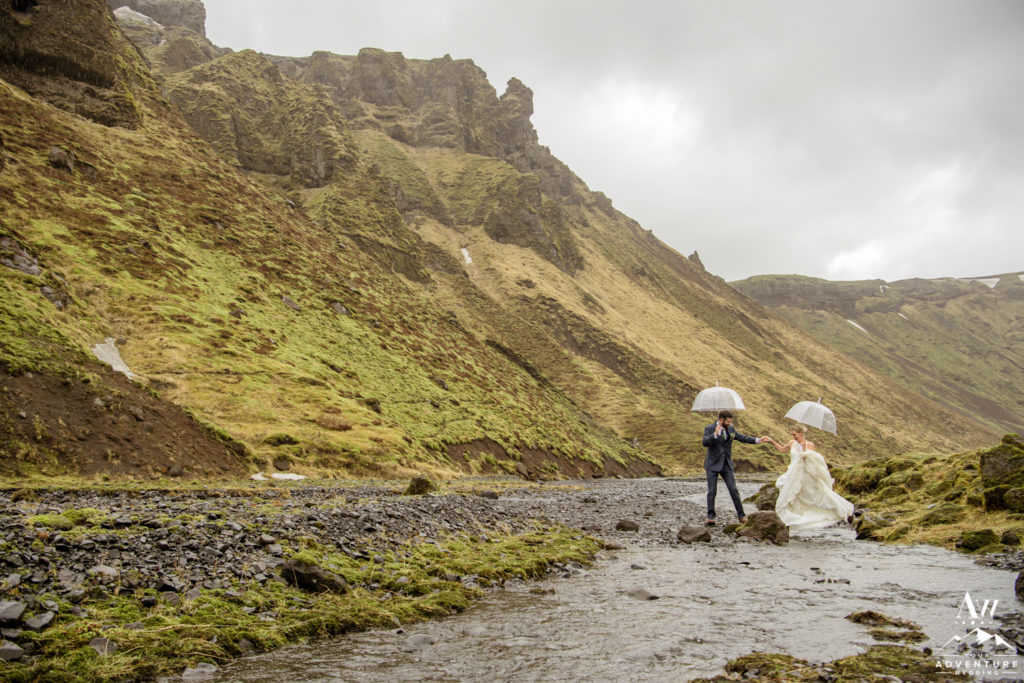 Iceland Wedding Couple Hiking over a River