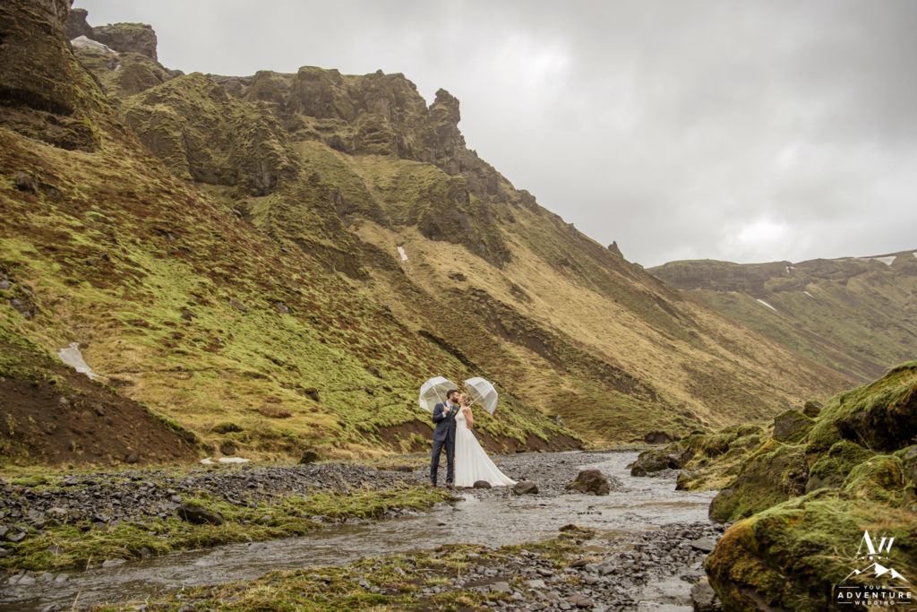 Iceland Wedding Couple Crossing a River on Wedding Day