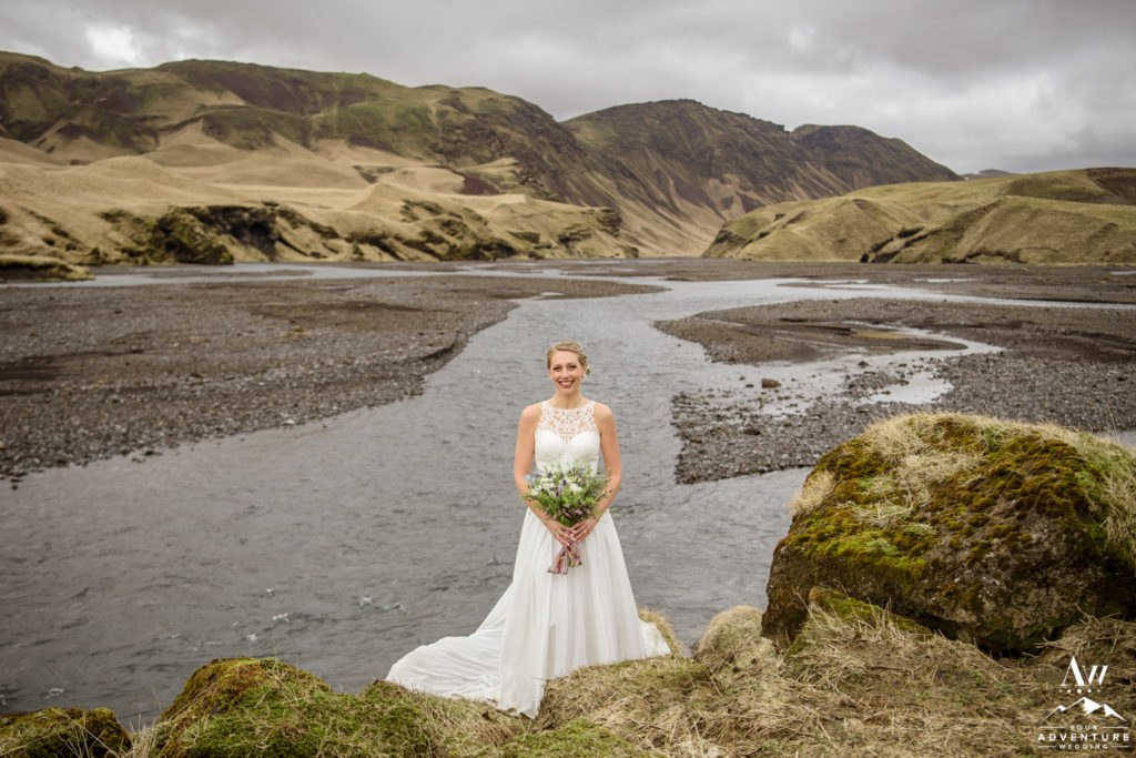 Bride standing in front of a private Canyon in Iceland
