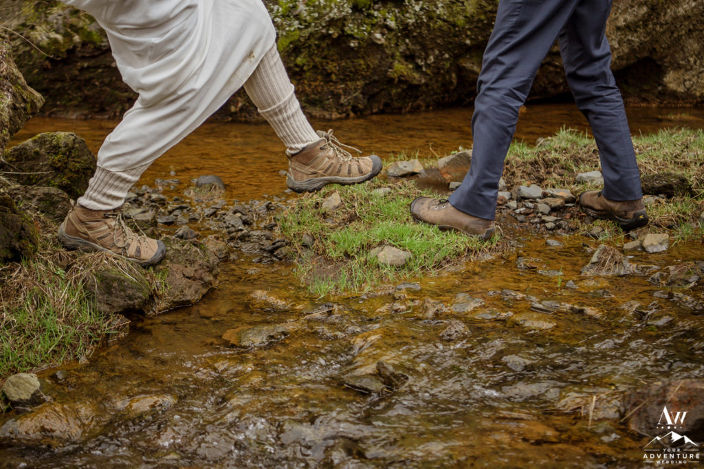 Couple Crossing a canyon during adventure wedding