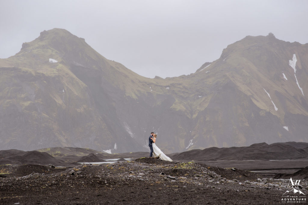 Iceland Wedding Couple Hugging during a rainy wedding day