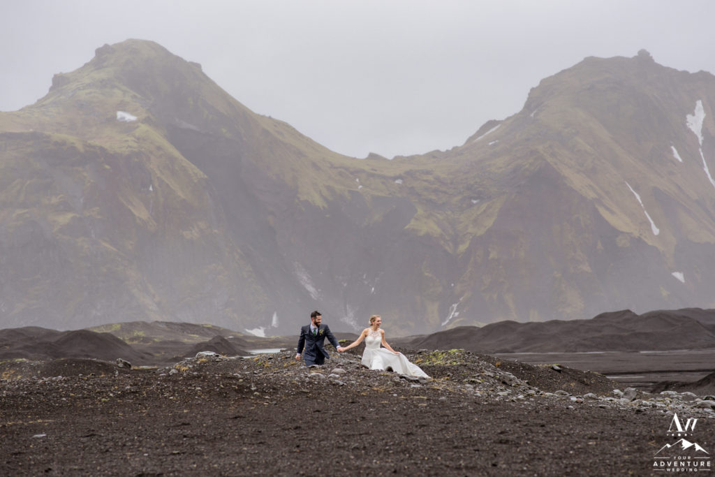 Adventure wedding couple hiking on wedding day
