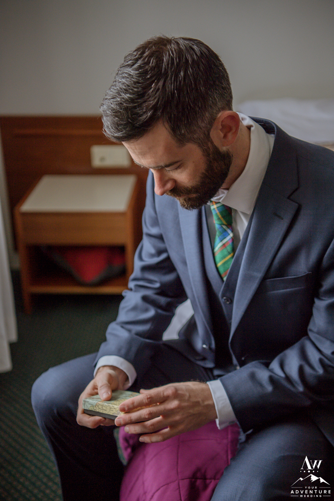 Groom opening his day of gift from Iceland bride