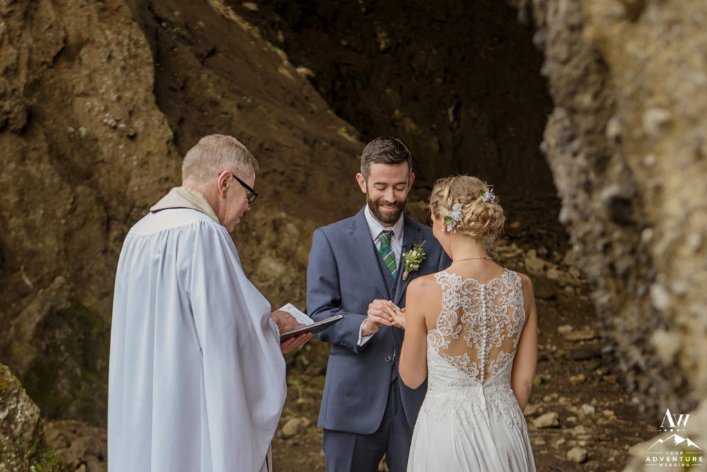 Bride and Groom Exchanging Rings in Cave