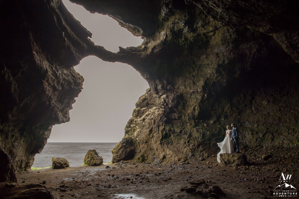 Iceland Wedding Couple inside of hjorleifshofdi cave