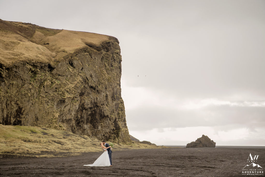 Iceland Wedding Couple Kissing outside of hjorleifshofdi