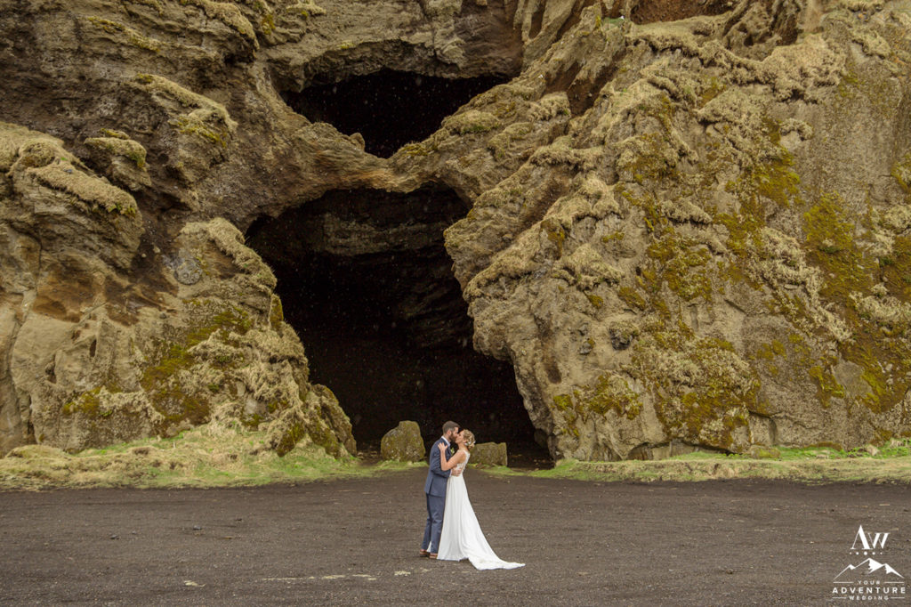 Iceland Wedding Couple outside of a private Cave