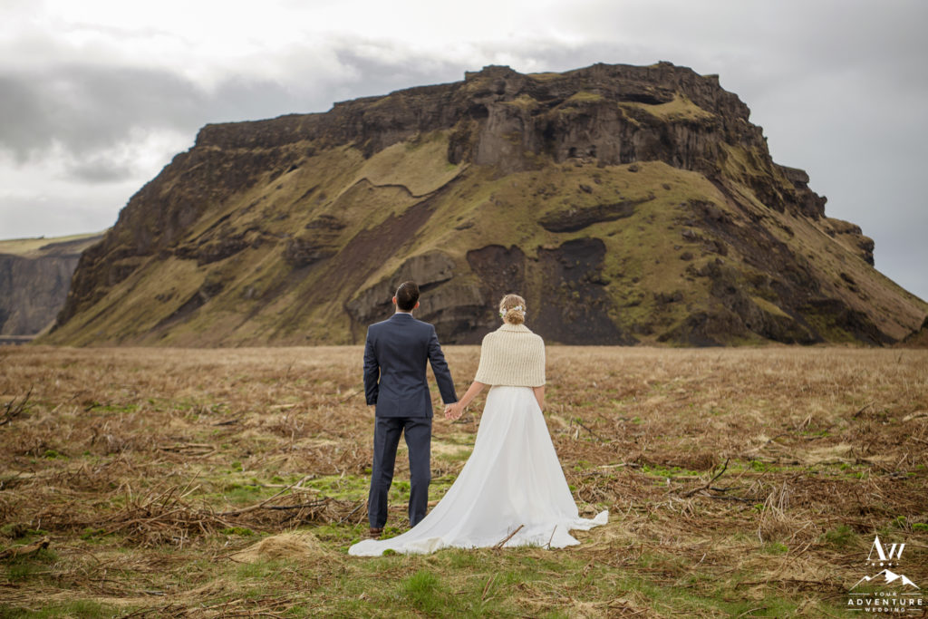 Iceland Wedding Couple outside of a mountain in Iceland