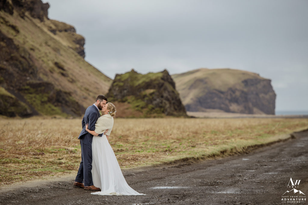Iceland Wedding Couple kissing outside of hjorleifshofdi cave