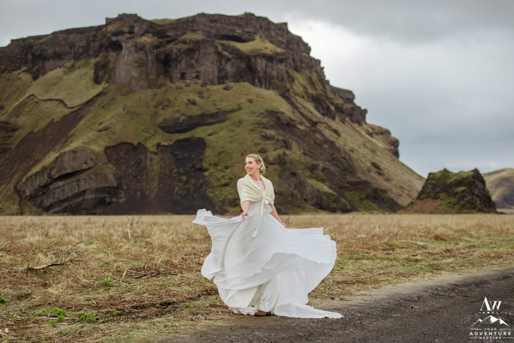 Iceland Wedding Bride Twirling in front of hjorleifshofdi mountain