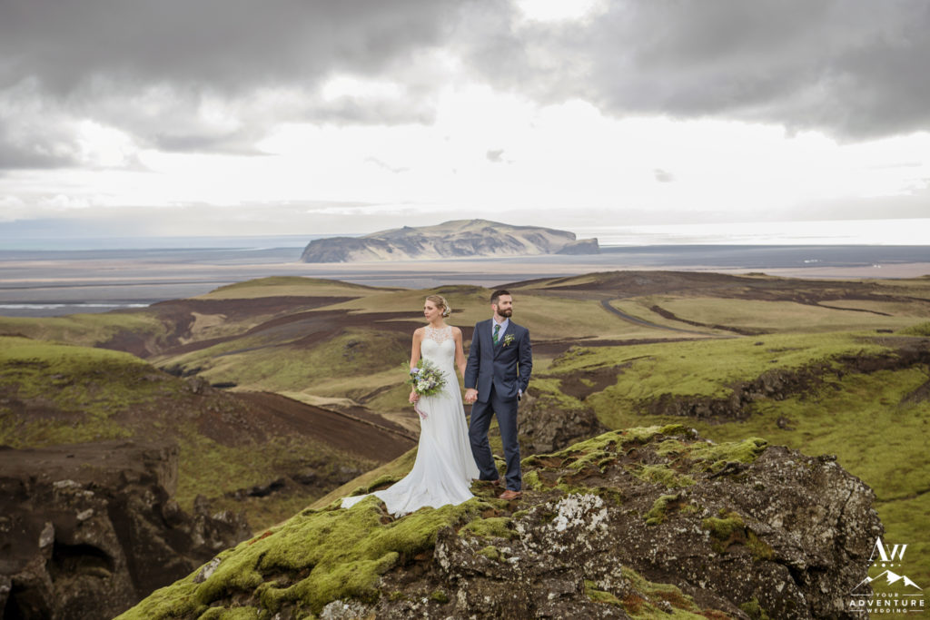 Couple Standing on mountain during Southern Iceland Wedding Adventure