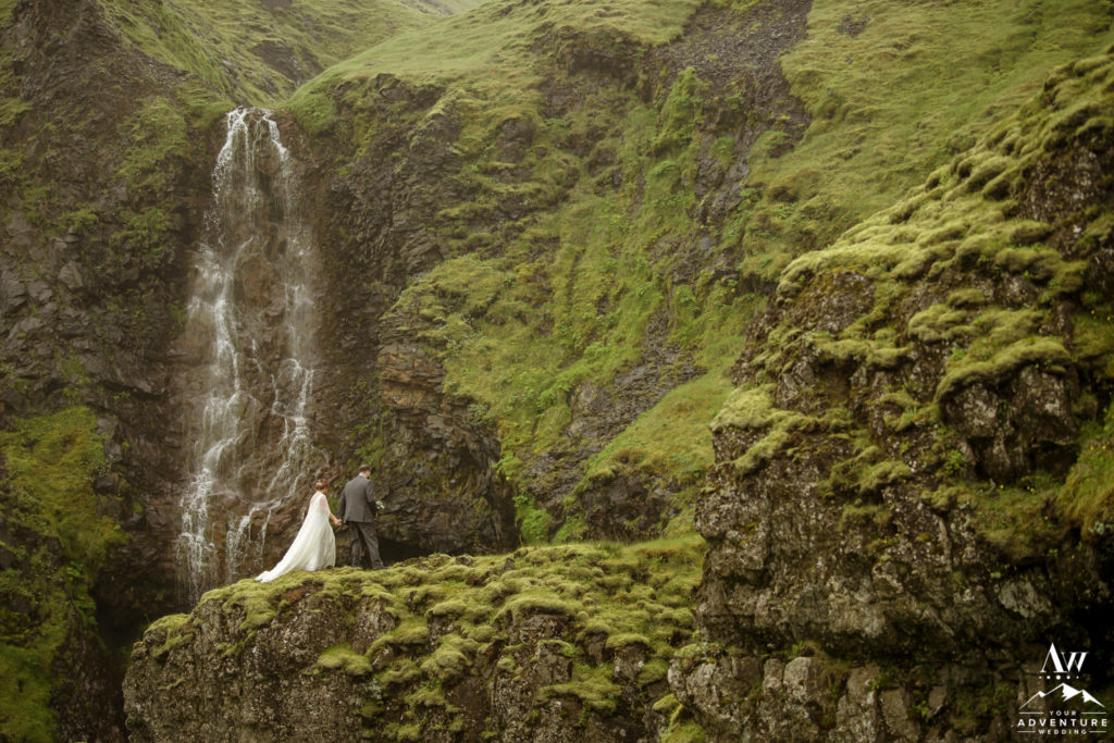 Couple exploring private waterfall in Iceland