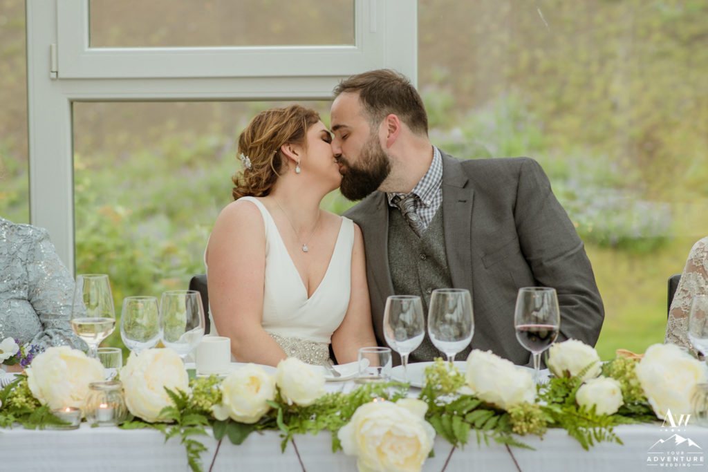 Couple kissing during Iceland Wedding Reception