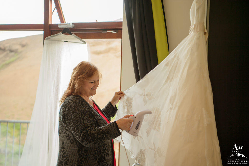 Mother of the Bride steaming the brides dress