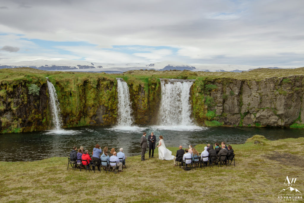 Iceland Wedding Ceremony at a Waterfall with glacier behind
