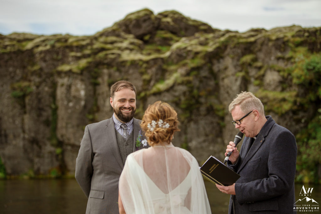 Groom smiling at bride during Iceland Wedding Ceremony