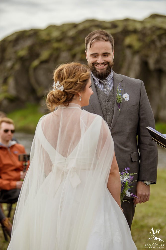 Groom smiling at Icelandic bride