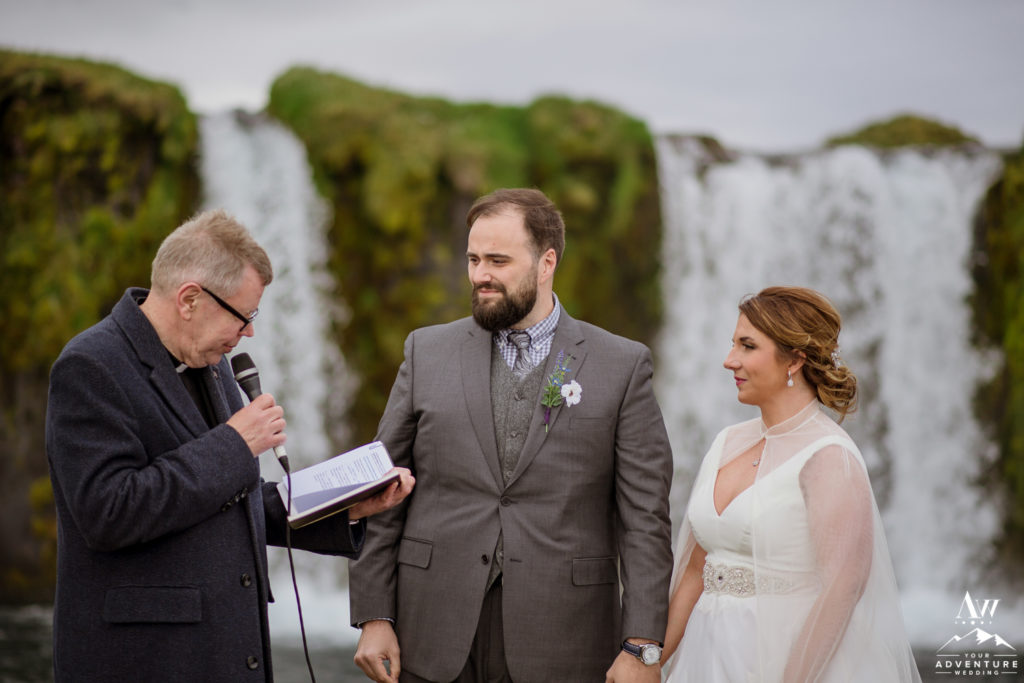 Iceland Wedding Couple in front of a waterfall