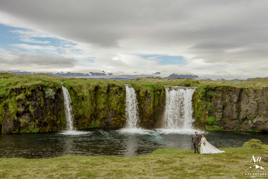 Iceland Wedding Couple Exploring private waterfall