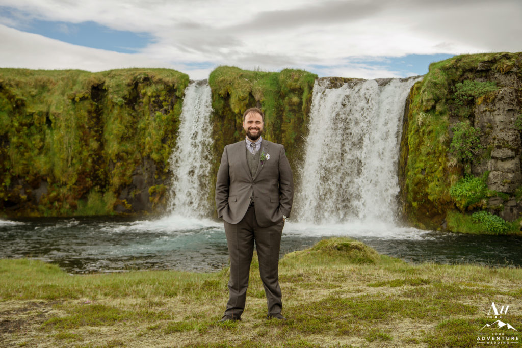 Groom in front of Private Waterfall in Iceland