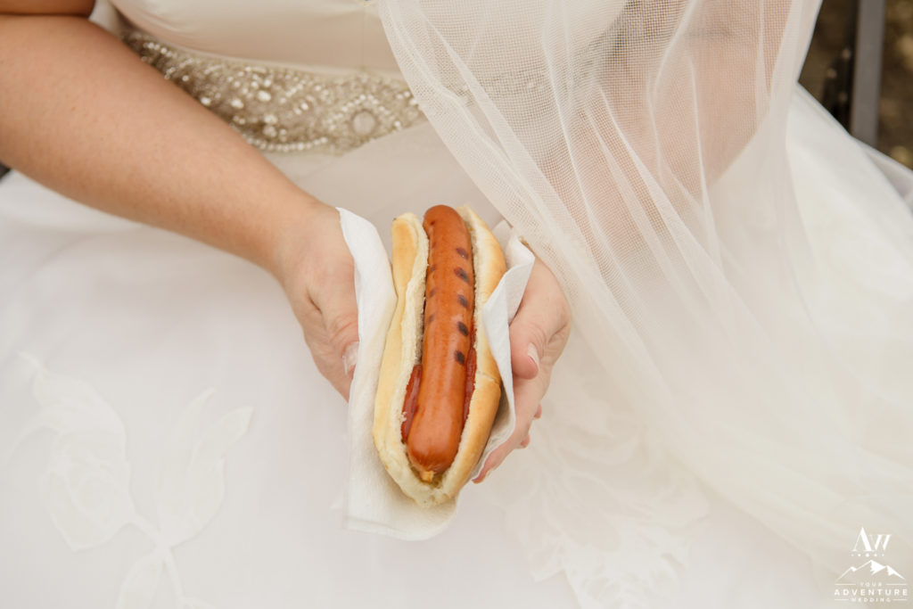 Iceland Hot Dog BBQ bride holding a hot dog