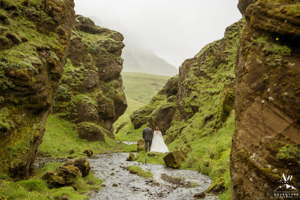Adventurous couple in Iceland in narrow canyon