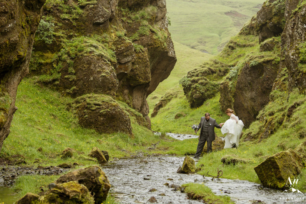 Iceland Wedding Couple hiking through narrow canyon