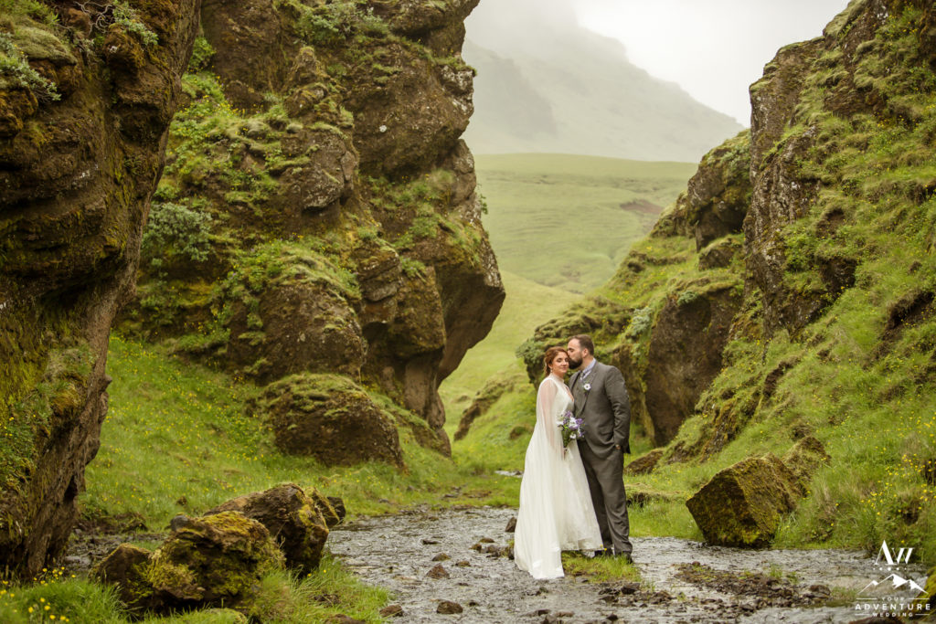 Couple kissing in narrow green canyon in Iceland