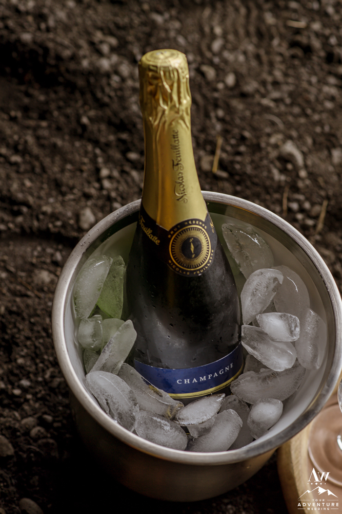 nicolas flueiite champagne during luxury picnic