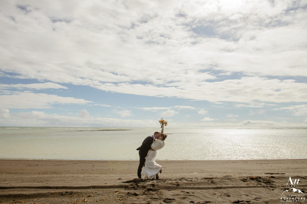 Iceland Wedding Couple celebrating on a black beach
