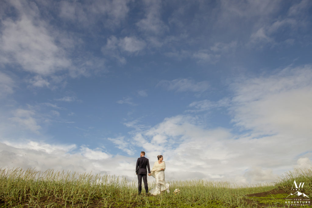 Blue Skies Iceland Wedding Photos on sand dunes