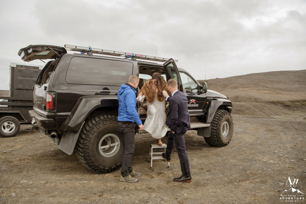 Bride exiting the super jeep for adventure wedding in Iceland