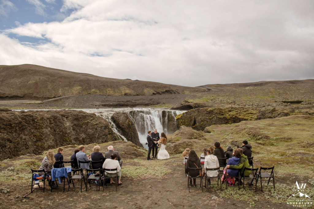 Iceland Wedding Ceremony with Guests at a hidden waterfall