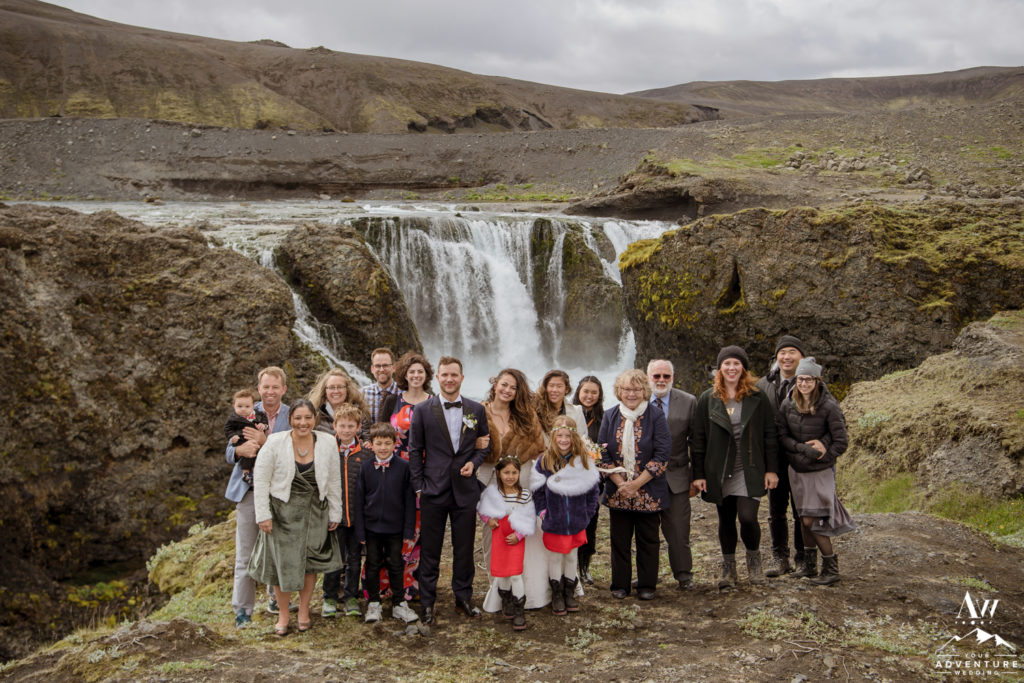 Iceland Wedding with guests at a waterfall