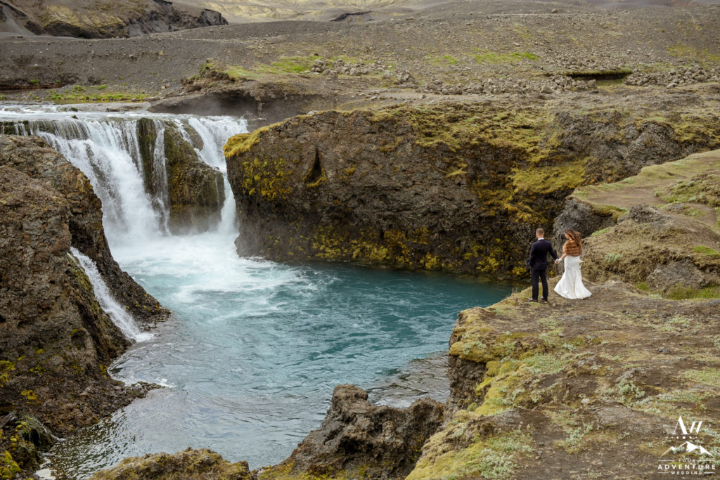 Iceland Wedding Couple Exploring a Hidden Waterfall