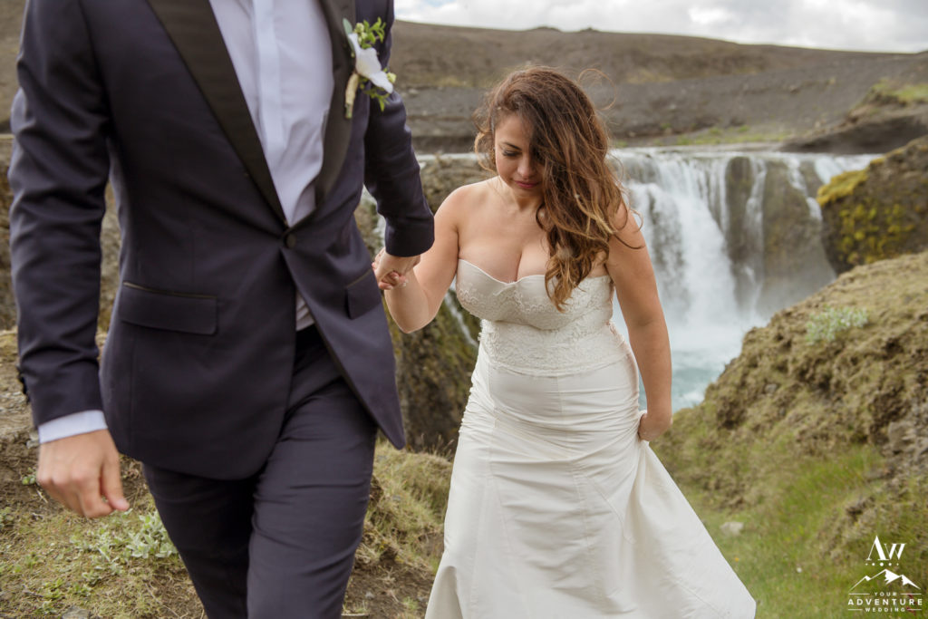 Iceland Wedding Couple exploring a secret waterfall
