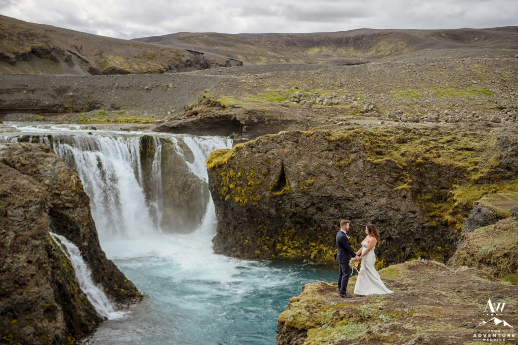 Iceland Wedding Couple Holding hands at private waterfall