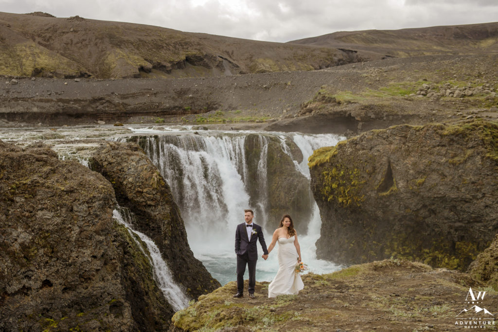 Iceland Wedding Couple Standing in Front of a waterfall