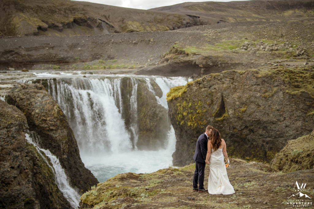 Couple kissing in front of a waterfall in Iceland