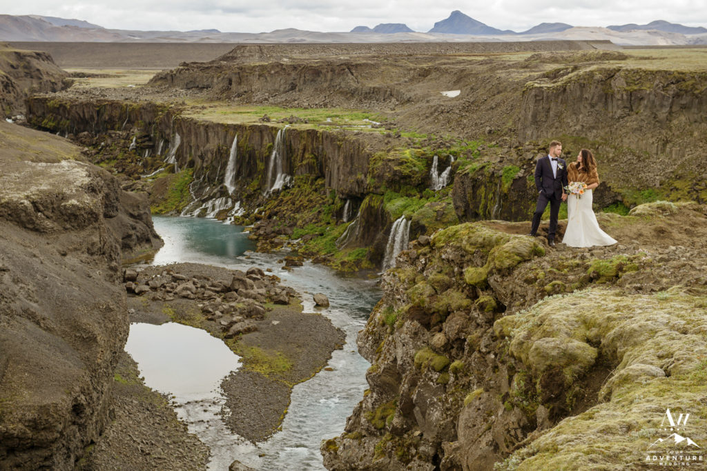 Iceland Wedding Couple at a Waterfall that looks like Jurassic Park