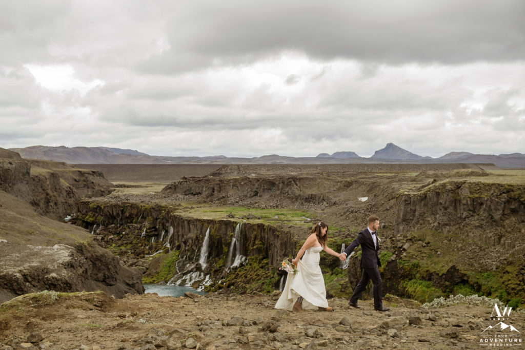 Iceland Wedding Couple exploring a unique waterfall