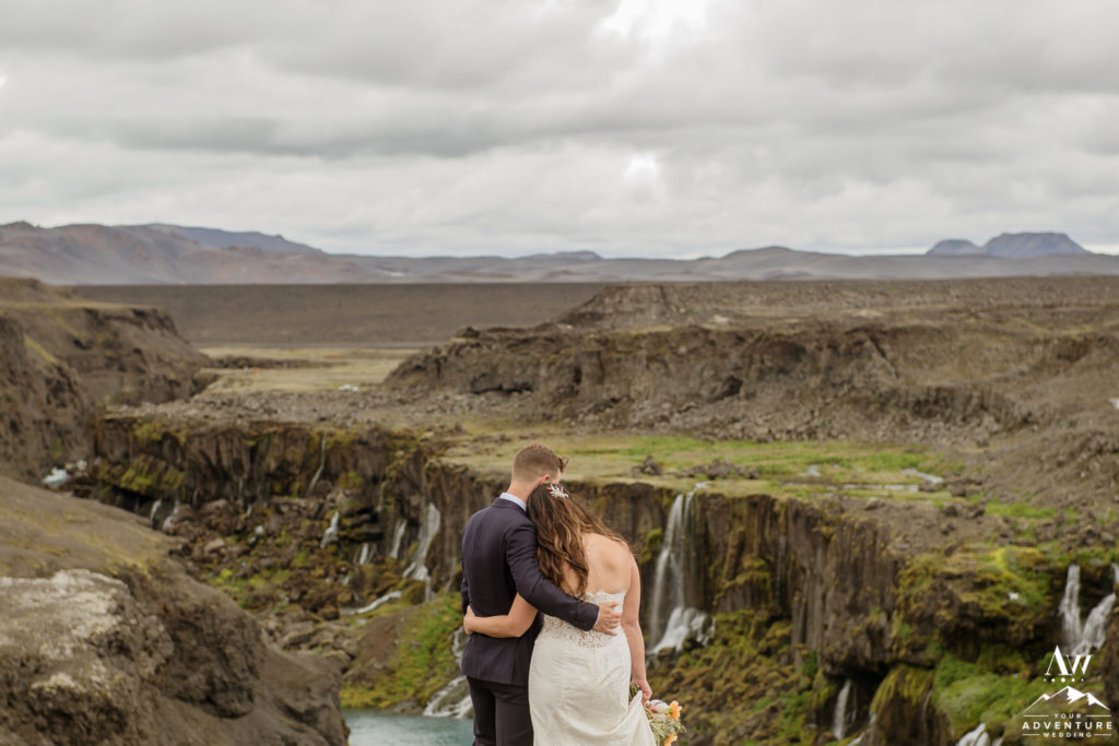 Couple cuddling in front of a canyon in Iceland