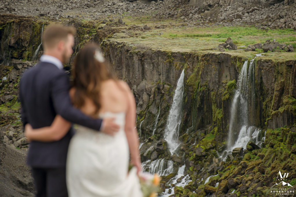 Iceland Canyon wedding photos with waterfall behind